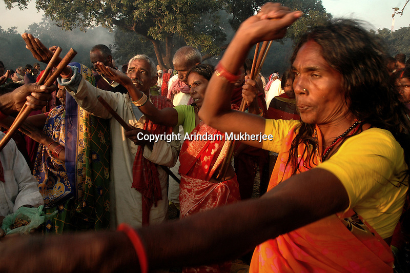 A women is performing black magic while hindu pilgrims pray to Sun god on the bank of river Gandak during Sonepur fair. Bihar, India, Arindam Mukherjee.