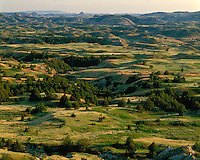 Evening light over the North Dakota Badlands as viewed from Boicourt Overlook; Theodore Roosevelt National Park, ND