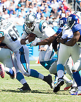 The Carolina Panthers played the New York Giants at Bank of America Stadium in Charlotte, NC.  The Panthers won 38-0 for their first victory of the season.  The Giants dropped to 0-3.  Carolina Panthers quarterback Cam Newton (1) makes a run.