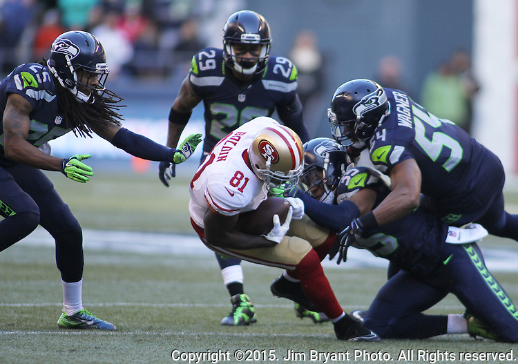 Seattle Seahawks defensive back DeShawn Shead (35) and linebacker Bobby Wagner (54) bring down San Francisco 49ers wide receiver Anquan Boldin (81) at CenturyLink Field in Seattle, Washington on November 22, 2015.  The Seahawks beat the 49ers 29-13.   ©2015. Jim Bryant Photo. All RIghts Reserved.