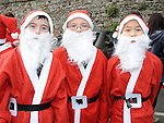 Matthew Askins, Shaun Crabtree and Kenny Sin who took part in the Santa Dash. Photo: Colin Bell/pressphotos.ie
