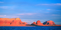 Moon rises over buttes at Lake Powell, Utah.
