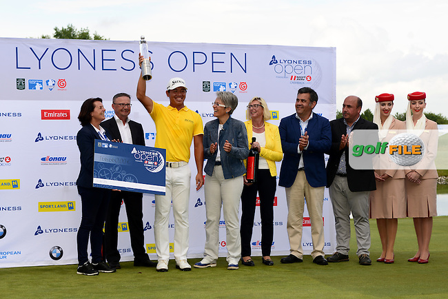Ashun Wu of China poses with the trophy after his 1 stroke victory during Round 4 of the Lyoness Open, Diamond Country Club, Atzenbrugg, Austria. 12/06/2016<br /> Picture: Richard Martin-Roberts / Golffile<br /> <br /> All photos usage must carry mandatory copyright credit (&copy; Golffile | Richard Martin- Roberts)