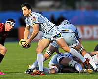 Hendon, England. Alex Walker of Cardiff Blues clears the ball during the LV= Cup match for the first professional rugby game on the artificial turf pitch made for rugby between Saracens and Cardiff Blues at Allianz Park Stadium on January 27, 2013 in Hendon, England.