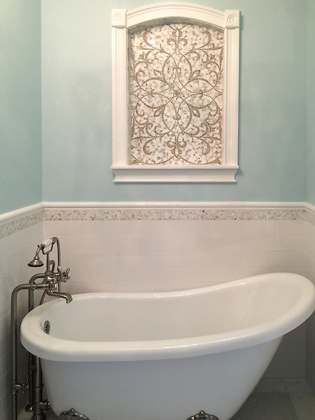 This custom Marabel mosaic niche is shown in polished Calacatta Baroque and honed Jura Grey.<br />