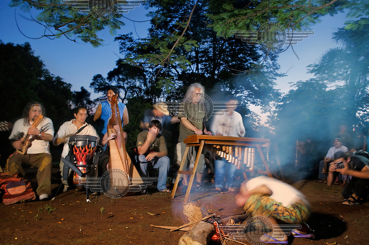 Musicians from Orquesta del Rio Infinito, an Afroamerican orchestra, playing in the Guarani (Amazionian Indians) village in Iguazu at the start of a tour along the Parana River.