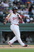 Designated hitter Rafael Devers (13) of the Greenville Drive bats in a game against the Charleston RiverDogs on Sunday, May 24, 2015, at Fluor Field at the West End in Greenville, South Carolina. Devers is the No. 6 prospect of the Boston Red Sox, according to Baseball America. Charleston won 3-2. (Tom Priddy/Four Seam Images)