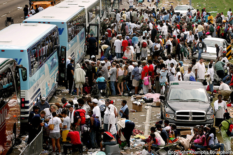 Hundreds of people wait to be evacuated to shelter at a makeshift transport hub on Interstate 10 and North Causeway Blvd. in Metairie near the edge of New Orleans on Thursday, September 1, 2005.  Hurricane Katrina caused many parts of the city to flood.  (photo by Khampha Bouaphanh)