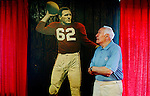 Former Chicago Cardinals football player Charley Trippi was inducted into the College Football Hall of Fame and the Pro Football Hall of Fame during his career in the sport. He admires a cut-out of himself that was displayed in Chicago for advertising in the early 1950s. He poses in his Athens, Georgia home. KENDRICK BRINSON