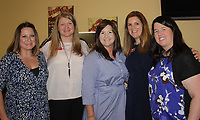 NWA Democrat-Gazette/CARIN SCHOPPMEYER Crystal Butler (from left), Misty Bolton-Samuels, Ashley Zulpo, Erin Hinz and Amber Holtz attend the Peace at Home expansion opening Sept. 6 at the shelter in Fayetteville.