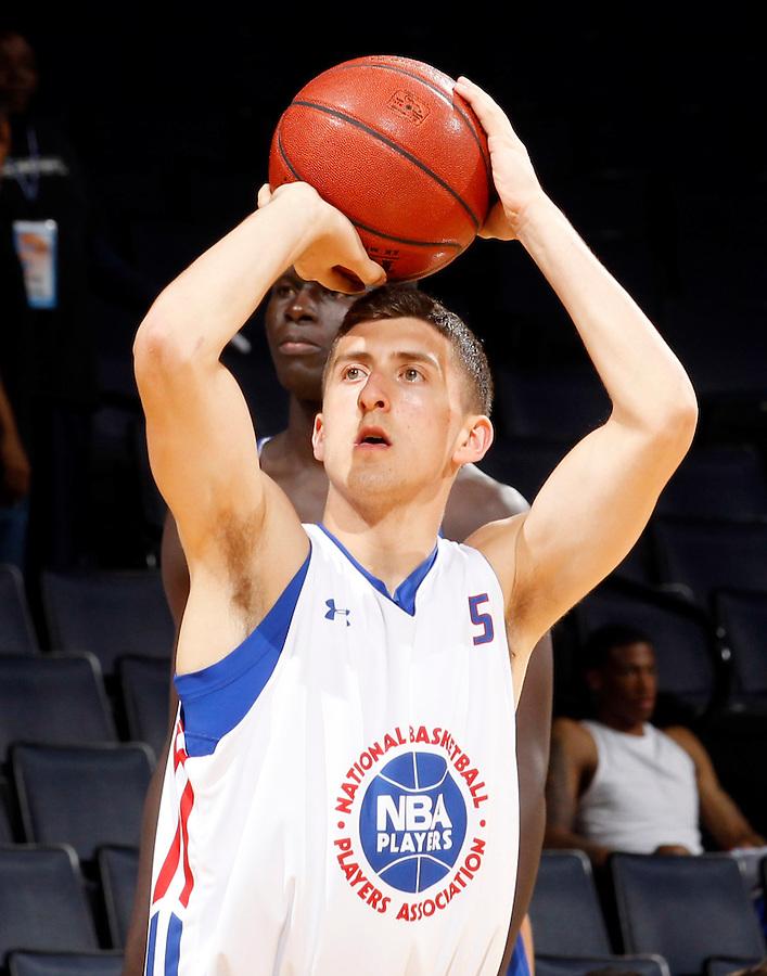 Jaren Sina participates in a basketball camp in Charlottesville, Va. (Photo/Andrew Shurtleff)