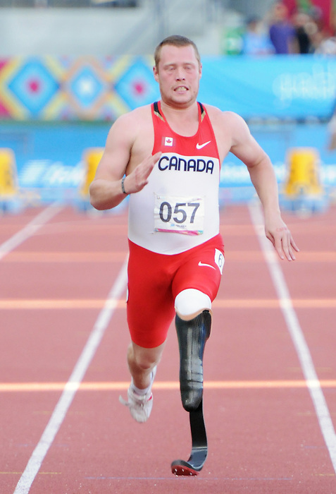 November 14 2011 - Guadalajara, Mexico: Alister McQueen during his race in the 100m Final at the 2011 Parapan American Games in Guadalajara, Mexico.  Photos: Matthew Murnaghan/Canadian Paralympic Committee