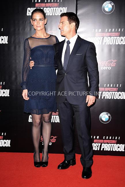 WWW.ACEPIXS.COM . . . . . December 19, 2011...New York City....Katie Holmes and Tom Cruise attend the 'Mission: Impossible - Ghost Protocol' U.S. premiere at the Ziegfeld Theatre on December 19, 2011 in New York City....Please byline: KRISTIN CALLAHAN - ACEPIXS.COM.. . . . . . ..Ace Pictures, Inc: ..tel: (212) 243 8787 or (646) 769 0430..e-mail: info@acepixs.com..web: http://www.acepixs.com .