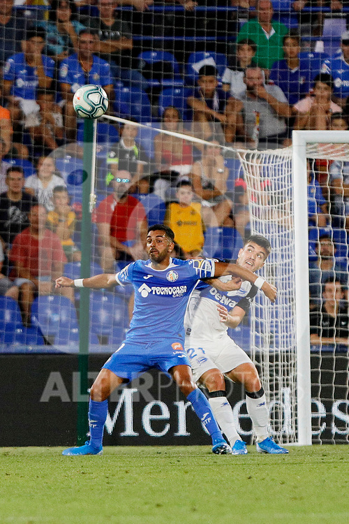 Angel Rodriguez of Getafe CF and Martin Aguirregabiria of Deportivo Alaves during La Liga match between Getafe CF and Deportivo Alaves at Colisseum Alfonso Perez in Getafe, Spain. August 31, 2019. (ALTERPHOTOS/A. Perez Meca)