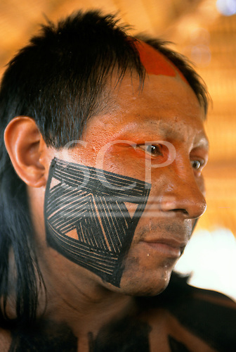 Bacaja village, Amazon, Brazil. A man with distinctive face paint, genipapu and charcoal; Xicrin tribe.
