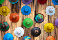A local artist in the Pindaya area in the Shan State decorated his building and small shop with painted traditional burmese Hats in many different colours. Myanmar, Burma.