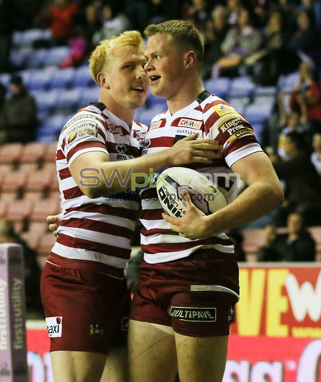 Picture by Paul Currie/SWpix.com - 01/05/2015 - Rugby League - First Utility Super League - Wigan Warriors v Hull Kingston Rovers- DW Stadium, Wigan, England - Wigan Warriors George Williams celebrates his hat trick with Wigan Warriors Dan Sarginson