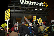 Washington, DC - November 25, 2014: Thousands of protesters marching in solidarity with protesters in Ferguson, MO, make an impromptu demonstration in front of the Walmart in the District of Columbia, November 25, 2014. A large group among the protesters took their demonstration inside of the store.  (Photo by Don Baxter/Media Images International)