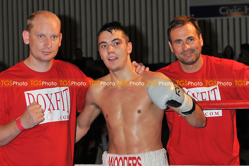 Billy Wooders (white shorts) defeats Aron Csipak in a Light-Middleweight boxing contest at Civic Hall, Grays, Essex - 05/10/12 - MANDATORY CREDIT: Philip Sharkey/TGSPHOTO - Self billing applies where appropriate - 0845 094 6026 - contact@tgsphoto.co.uk - NO UNPAID USE.