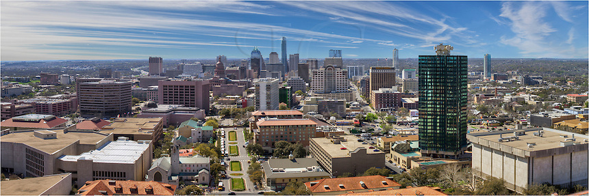 Taken from the famous University of Texas Tower's observation deck, this panorama looks south at the Austin skyline. To the right is Dobie Hall, a large dormatory. In the distance rises the Austonian flanked by the iconic Frost Bank Tower.