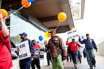 People march through downtown Atlanta, Georgia before a rally for MARTA, Atlanta's public transit bus and train system, at the Five Points MARTA station in Atlanta, Georgia April 20, 2010.