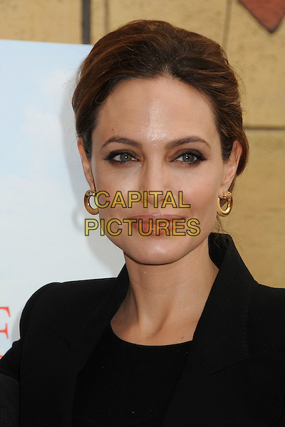 Angelina Jolie.American Cinematheque 69th Annual Golden Globe Awards Foreign-Language Nominee Directors Panel held at the Egyptian Theatre, Hollywood, California, USA, 14th January 2012..portrait headshot  hair up earrings beauty black  gold hoop hoops .CAP/ADM/BP.©Byron Purvis/AdMedia/Capital Pictures.