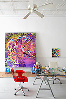 abstract painting<br /> <br /> A 2500 sq. ft loft in the Tribeca area of New York City used by artist Joanne Greenbaum as her studio and living space full of artwork, pottery and collections all displayed on shelves.