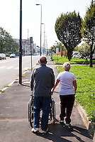 Milano, periferia est. Anziani con carrozzella --- Milan, east periphery. Elderly with wheelchair