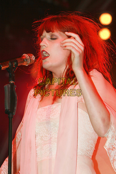 FLORENCE WELCH.Florence and The Machine perform live at Somerset House, London, England..July 15th, 2010.stage concert live gig performance music half length white dress singing hand profile mouth open .CAP/MAR.© Martin Harris/Capital Pictures.
