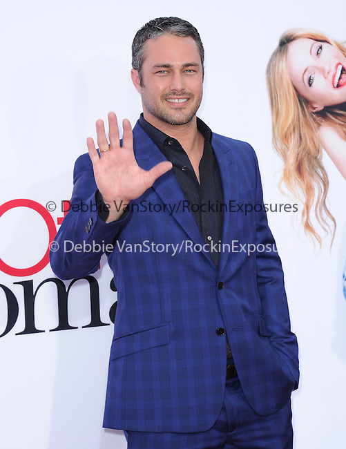 Taylor Kinney attends The Twentieth Century Fox L.A. Premiere of Th eOther Woman held at The Regency Village Westwood in Westwood, California on April 21,2014                                                                               © 2014 Hollywood Press Agency