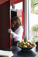 Owner Sarah Russo admires the contents of her kitchen cupboard