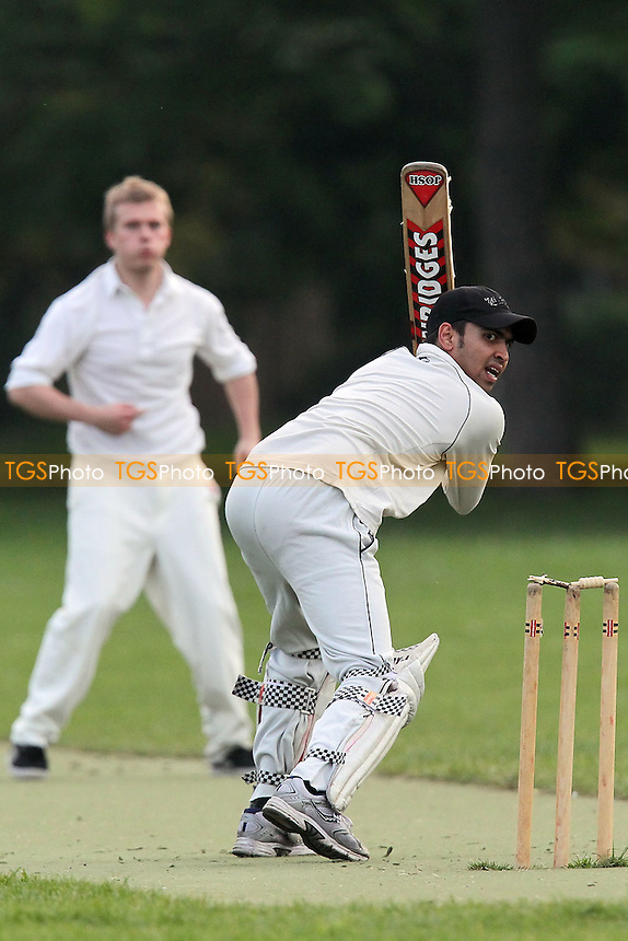 The Pumas CC (fielding) vs Martians CC - Victoria Park Community Cricket League at Victoria Park, London - 21/05/12 - MANDATORY CREDIT: Gavin Ellis/TGSPHOTO - Self billing applies where appropriate - 0845 094 6026 - contact@tgsphoto.co.uk - NO UNPAID USE.