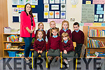 Class teacher Aine O'Shea with her new junior infants front l-r Aine Herlihy, Eimear Buckely and Isabelle Carey back l-r Emmy O'Donoghue, Paudie O'Leary, Robyn O'Rahilly and Tiernan Cronin on their first day of school in Knockanes NS last Thursday.