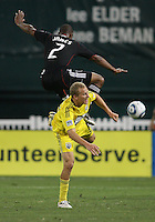 Julius James #2 of D.C. United  leaps high over Steven Lenhart #32 of the Columbus Crew during an MLS match at RFK Stadium on September 4 2010, in Washington DC. Columbus won 1-0.