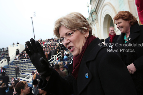 United States Senator Elizabeth Warren (Democrat of Massachusetts) waves during the presidential inauguration on the West Front of the U.S. Capitol January 21, 2013 in Washington, DC.   Barack Obama was re-elected for a second term as President of the United States.      .Credit: Win McNamee / Pool via CNP