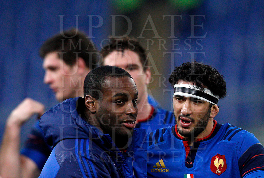 Rugby, Torneo Sei Nazioni: Italia vs Francia. Roma, stadio Olimpico, 15 marzo 2015.<br /> France's Eddy Ben Arous, left, and Yoann Huget celebrate at the end of the Six Nations championship rugby match between Italy and France at Rome's Olympic stadium, 15 March 2015. France won 29-0.<br /> UPDATE IMAGES PRESS/Riccardo De Luca