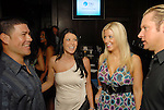Humberto Quintero and his wife Michelle with Pamela and Jason Michaels at the Astros Wives party at Mo's..A Place for Steaks Sunday evening June 07,2009.(Dave Rossman/For the Chronicle)