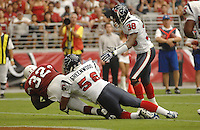 Aug 18, 2007; Glendale, AZ, USA; Arizona Cardinals running back Edgerrin James (32) falls into the end zone for a touchdown while being tackled by Houston Texans linebacker Morlon Greenwood (56) in the second quarter at University of Phoenix Stadium. Mandatory Credit: Mark J. Rebilas-US PRESSWIRE Copyright © 2007 Mark J. Rebilas