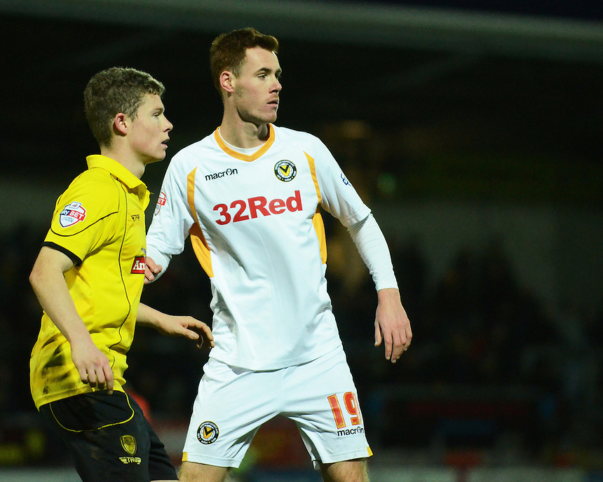 Newport County's Tom Naylor (right) and Burton Albion's Matthew Palmer in action during todays match  <br /> <br /> Photo by Kevin Barnes/CameraSport<br /> <br /> Football - The Football League Sky Bet League Two - Burton Albion v Newport County - Sunday 29th December 2013 - Pirelli Stadium - Burton upon Trent<br /> <br /> &copy; CameraSport - 43 Linden Ave. Countesthorpe. Leicester. England. LE8 5PG - Tel: +44 (0) 116 277 4147 - admin@camerasport.com - www.camerasport.com