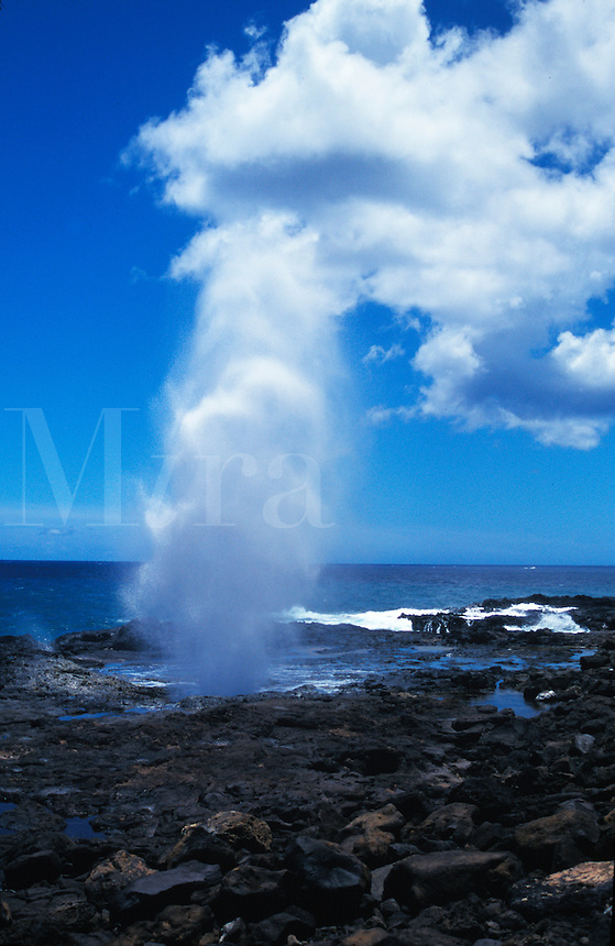Water erupting through blowhole in Hawaii.