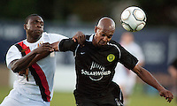 Manchester City midfielder Jeremy Helan goes for a ball against Portland Timbers defender Scot Thompson during a match at Merlo Field in Portland Oregon on July 17, 2010.