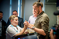 Pictured: Gareth Bale meets a young fan at his Elevens Bar in Cardiff, Wales, UK. Thursday 12 July 2018<br /> Re: Last night (Thurday 12 July) Elevens Bar &amp; Grill and the Football Association of Wales jointly hosted a Q&amp;A evening with Gareth Bale. At the event, Gareth unveiled a new piece of memorabilia for Elevens &ndash; his match worn boots from this year&rsquo;s Champions League Final with which he scored that incredible overhead kick.<br /> The event, hosted at Elevens Bar &amp; Grill was open to members of the public with doors opening at 6pm on Thursday evening. People started queueing from 3pm, with a cross-section of fans of all ages in Wales shirts and bucket hats. <br /> The Q&amp;A, conducted by Ian Gwyn Hughes from the FAW, discussed all aspects of his career so far, from growing up in Cardiff to winning 4 Champions League medals with Real Madrid. On growing up in Whitchurch, Gareth said: &ldquo;My family were a huge influence on me growing up. My parents were so supportive, taking me here there and everywhere so I could play football. Growing up I can hardly remember not being with a football &ndash; I even took one to bed!&rdquo;<br /> There were a lot of youngsters in the audience, eager to hear from their hero. Gareth&rsquo;s advice to them? &ldquo;Work hard for what you want and who knows where that could take you.&rdquo;<br /> As a left-footer, Ryan Giggs,  Wales&rsquo; national team manager was someone he looked up to growing up. Gareth mentioned it was great to beat Ian Rush&rsquo;s goal scoring record for Wales with his childhood idol as manager. &ldquo;I knew I&rsquo;d levelled his record at half time, I needed one more to break it. The manager wanted to take me off but I said give me another 15 minutes to see if I can do it. Luckily on 61 minutes our goalkeeping coach took too long to do the substitution on the paper, so it gave me an extra minute. It worked out perfectly.&rdquo;