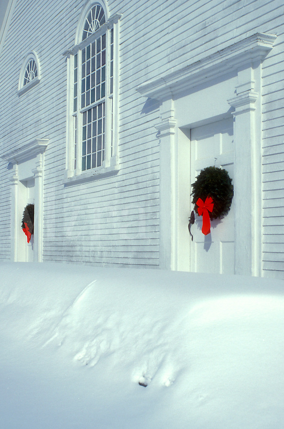 church, Vermont, VT, Union Meeting House (1825) decorated with wreaths on the doors in the winter in Burke Hollow.