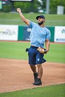Corpus Christi Hooks infielder Abraham Toro (13) warms up on May 1, 2019, at Arvest Ballpark in Springdale, Arkansas. (Jason Ivester/Four Seam Images)