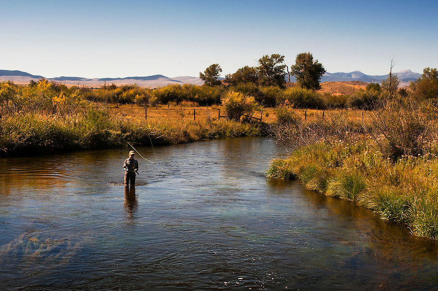 A woman fishes Poindexter Slough near Dillon, Montana.