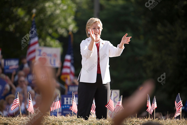 Senator Hillary Clinton (D-New York), potential Democratic Presidential candiate, attends a campaign rally. Her husband, former U.S. President William (Bill) Clinton attended the event, to give his support. Cedar Rapids, Iowa, July 4, 2007.