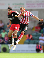 Lincoln City's Lee Frecklington vies for possession with Swindon Town's Steven Alzate<br /> <br /> Photographer Chris Vaughan/CameraSport<br /> <br /> The EFL Sky Bet League Two - Lincoln City v Swindon Town - Saturday 11th August 2018 - Sincil Bank - Lincoln<br /> <br /> World Copyright &copy; 2018 CameraSport. All rights reserved. 43 Linden Ave. Countesthorpe. Leicester. England. LE8 5PG - Tel: +44 (0) 116 277 4147 - admin@camerasport.com - www.camerasport.com