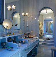 Pale grey marble bathroom with arch through to sunken bath