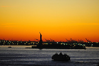 Nov. 12, 2010 - New York City, NY - The sun sets behind the Statue of Liberty in New York City November 12, 2010. (Photo by Alan Greth)