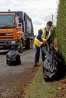 Dustbin men collecting rubbish to put into the dustcart..©shoutpictures.com..john@shoutpictures.com